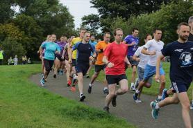 Runners running in Portobello. Running.